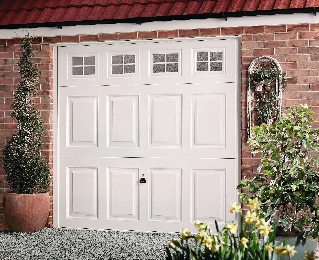 Garador beaumont with windows lakes garage doors for Daylight motors beaumont tx