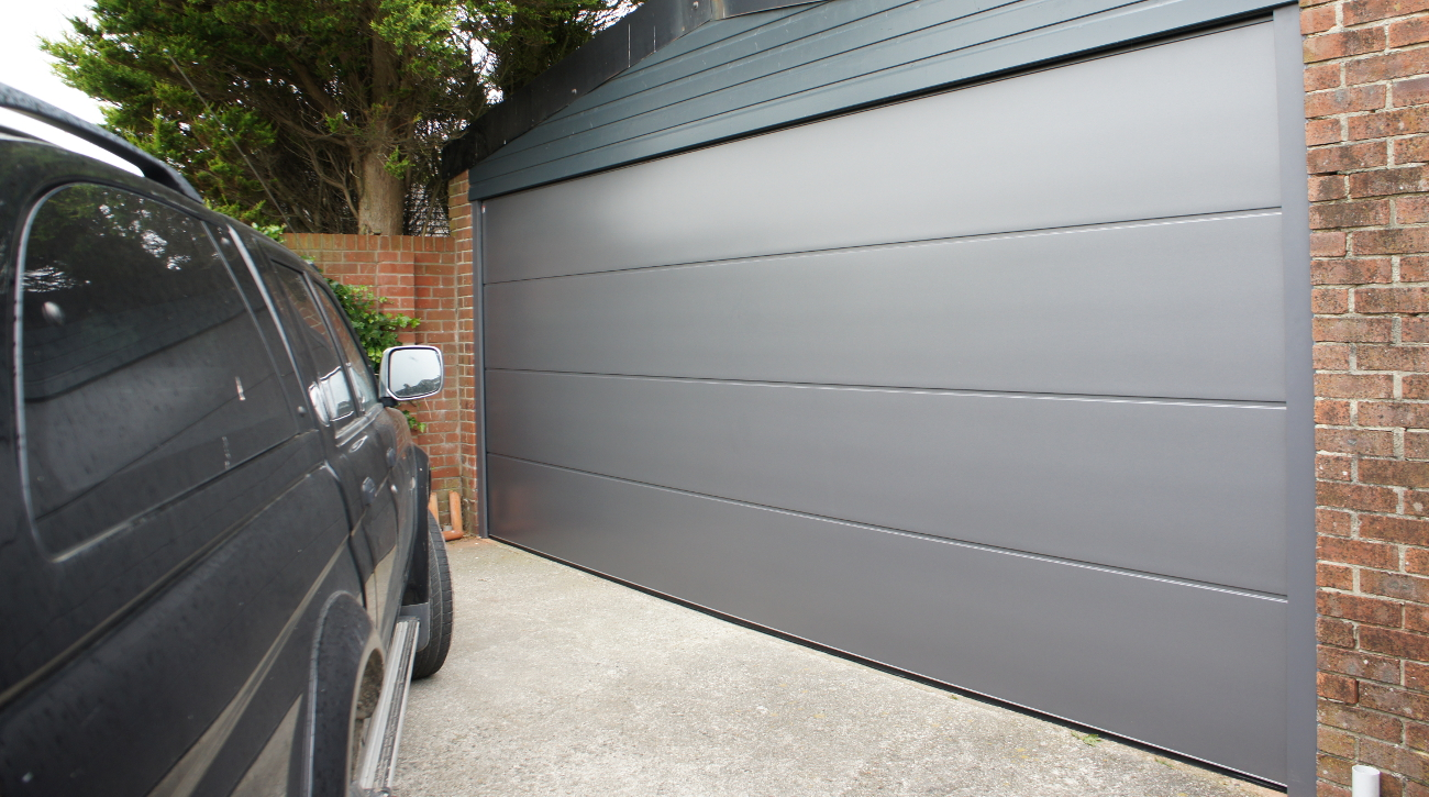 Metal garage doors lakes doors for Sectional glass garage door