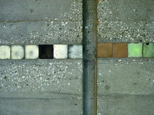 Mosaic inlay on concrete front door