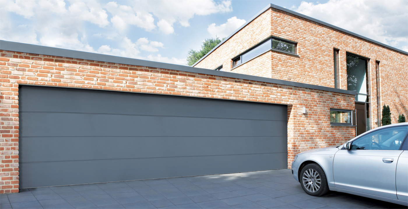 Carteck supersize unribbed lakes doors for Oversized garage doors